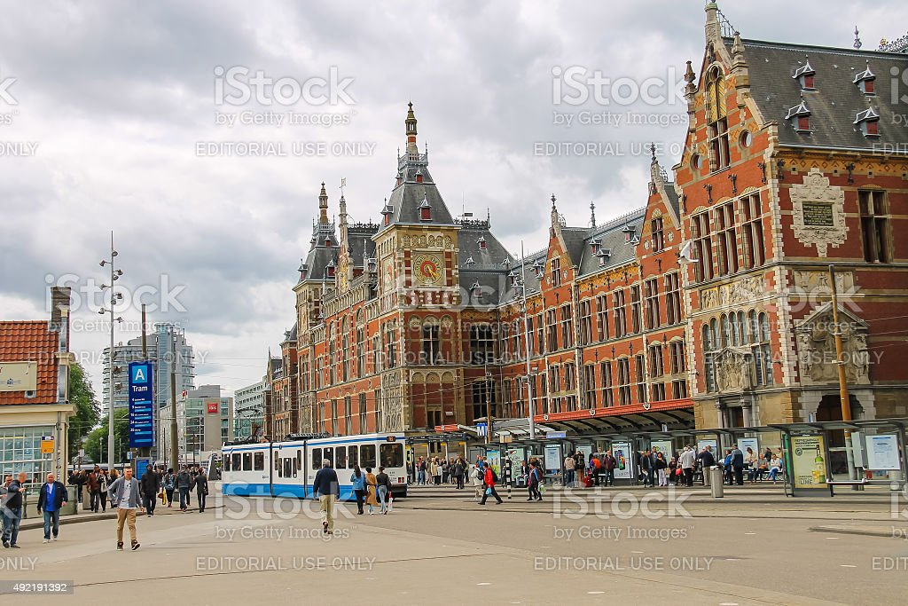 People in front of the Central Station building in Amsterdam stock photo