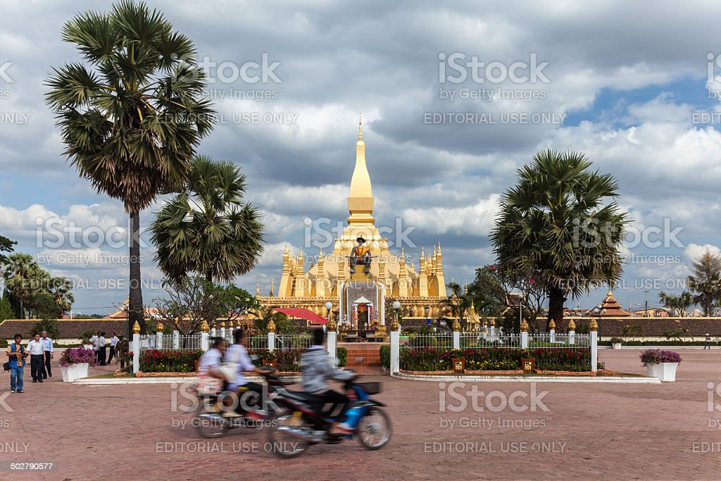People in front of Wat Pha That Luang royalty-free stock photo