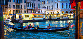 People in gondola at the canal of Venice