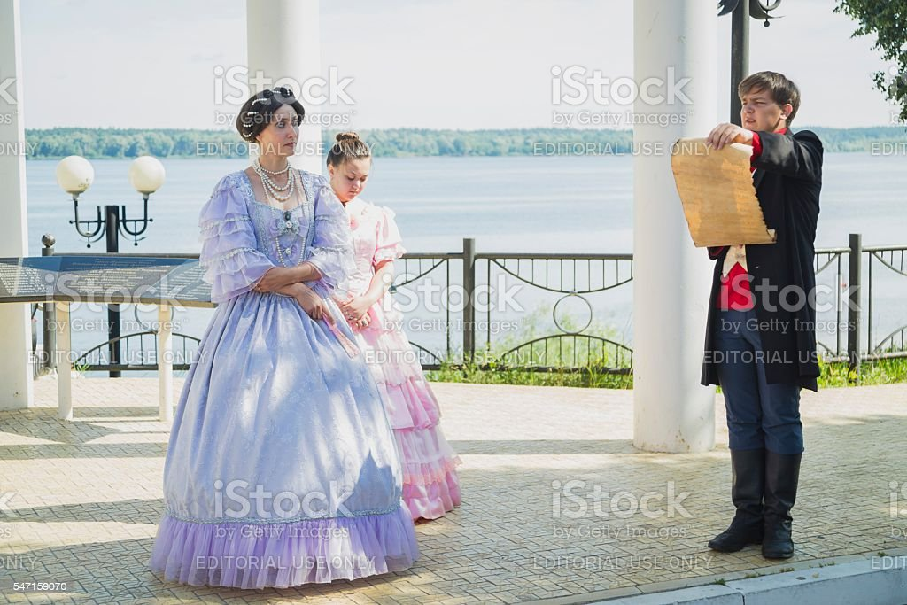 People in historical costumes meet passengers stock photo