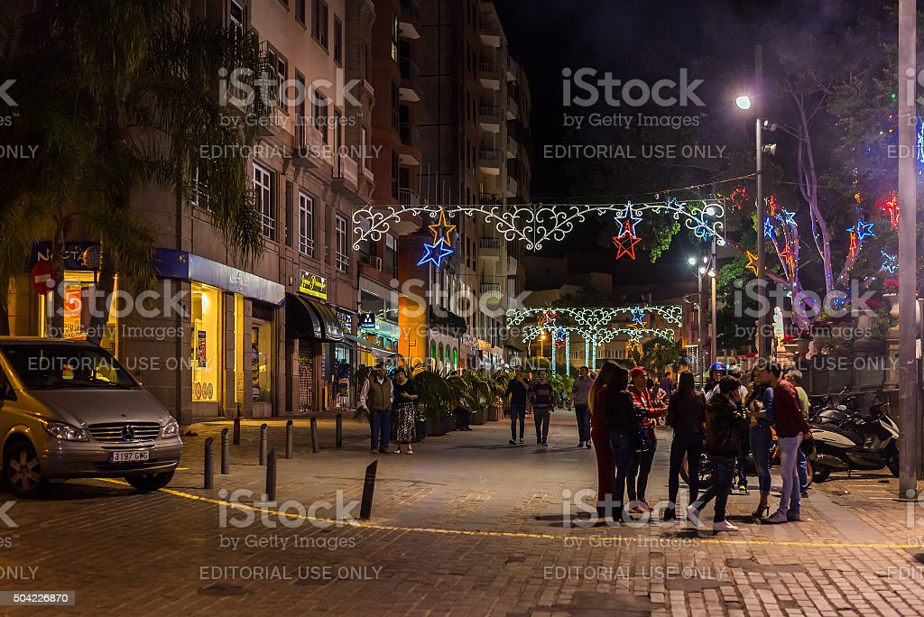 People in illuminated Christmas night streets of Santa Cruz stock photo