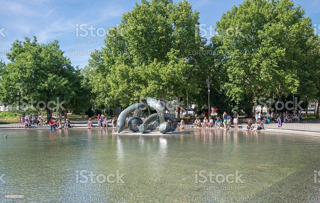 People in Karlsplatz fountain - Vienna stock photo