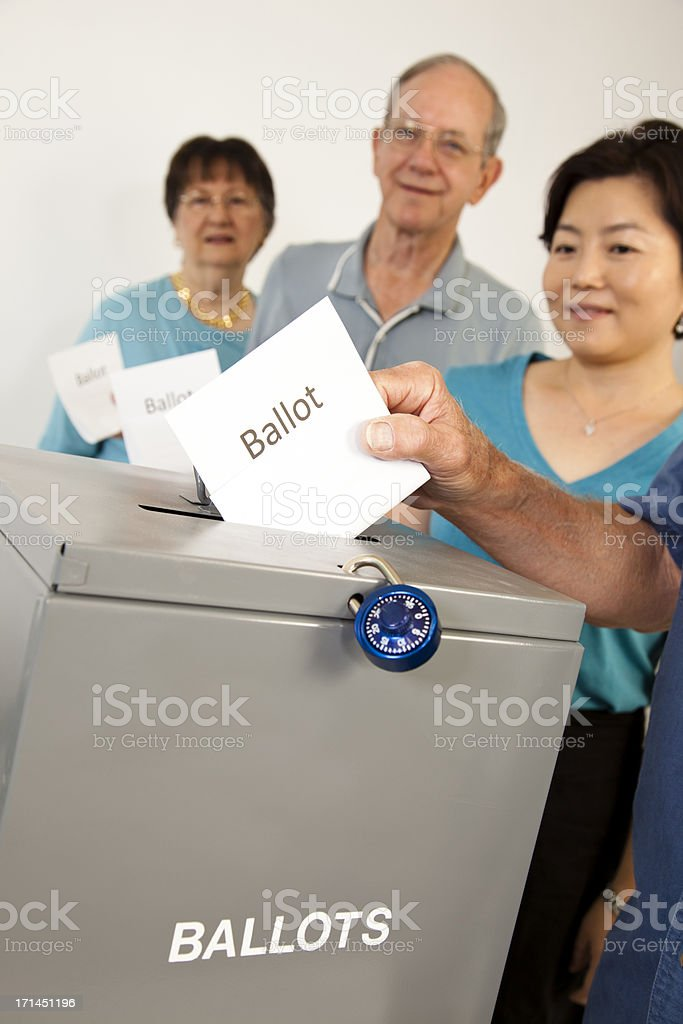 People in line casting votes. Voting political election. Ballot box. stock photo