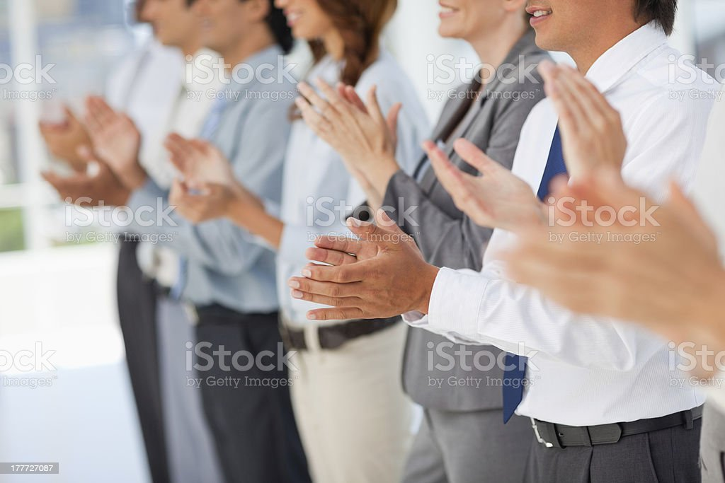 People in line clapping royalty-free stock photo