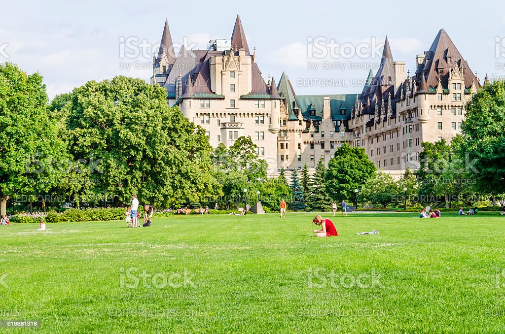 People in Majors Hill Park by Fairmont Château Laurier hotel stock photo