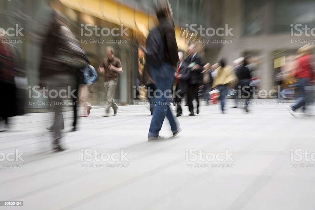 people in motion at modern shopping mall commuters royalty-free stock photo