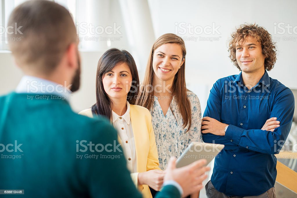 People in office building talking about financing stock photo