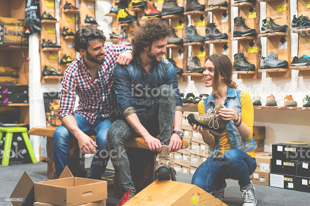 People in outdoor shoe store stock photo