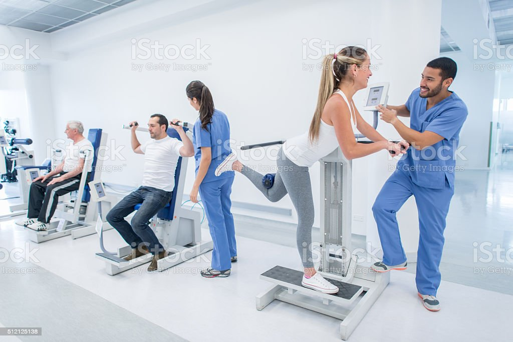 People in physical therapy at the hospital stock photo