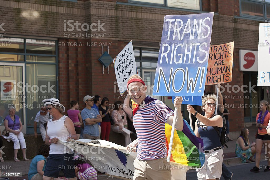 People in Pride Parade Carrying Protest Signs royalty-free stock photo