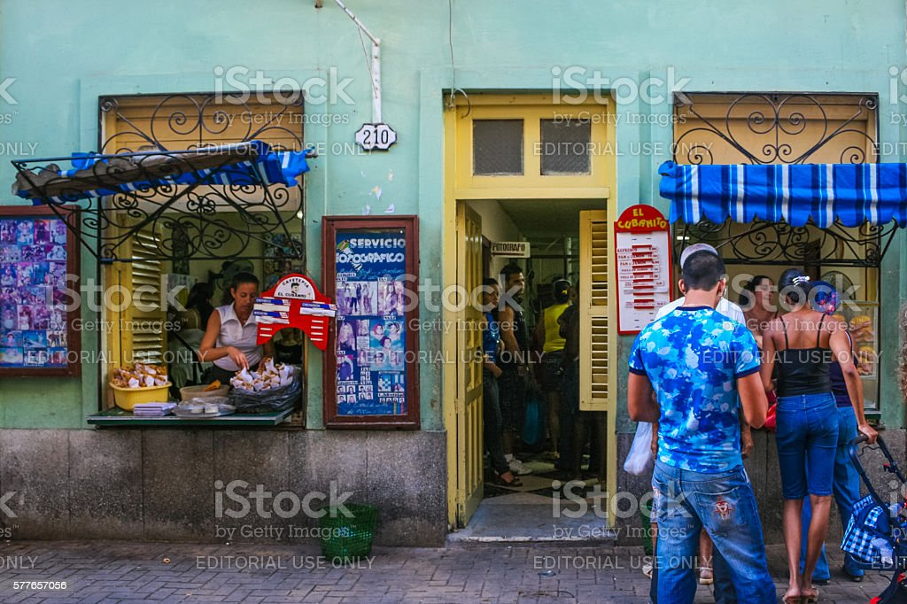 People in queue outside a cuban fast food restaurant, Havana stock photo