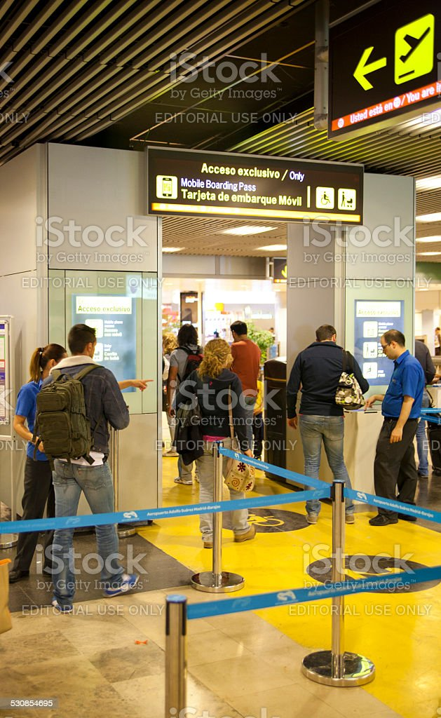 People in queue  waiting to registration. Madrid airport interior stock photo
