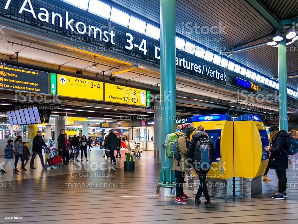 People in railway terminal at Schiphol Amsterdam Airport, Hollan stock photo