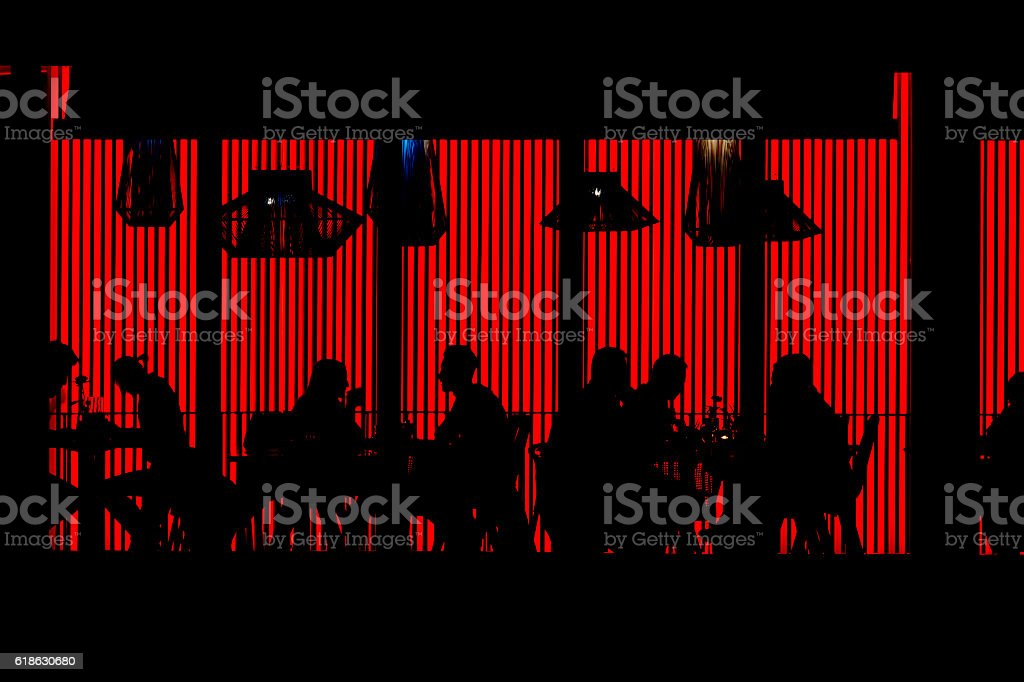 People in Red Cafe at Night stock photo