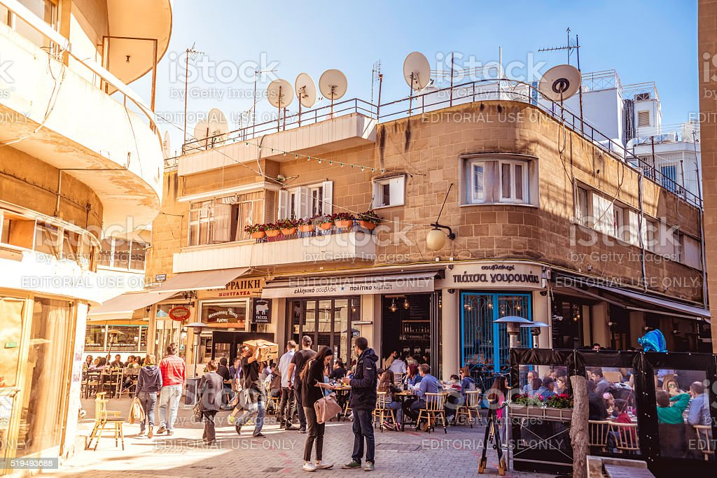 People in restaurants and traditional coffee shops at Ledra street. stock photo
