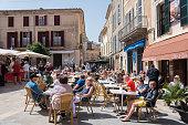 People in restaurnat at city market day in Sineu Mallorca