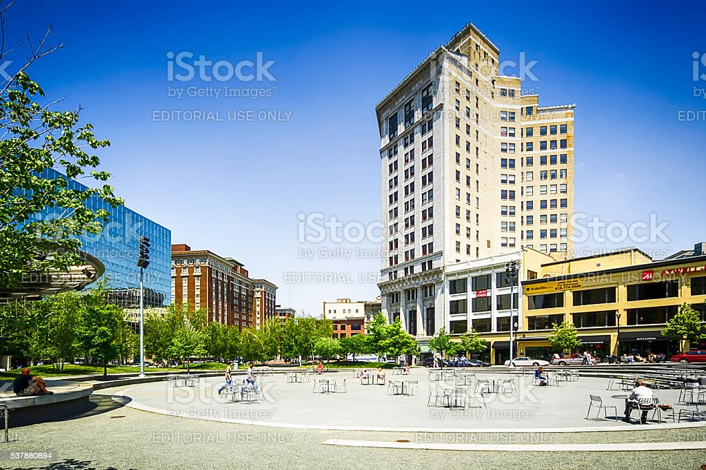 People in Rosa Parks Circle in Grand Rapids MI stock photo