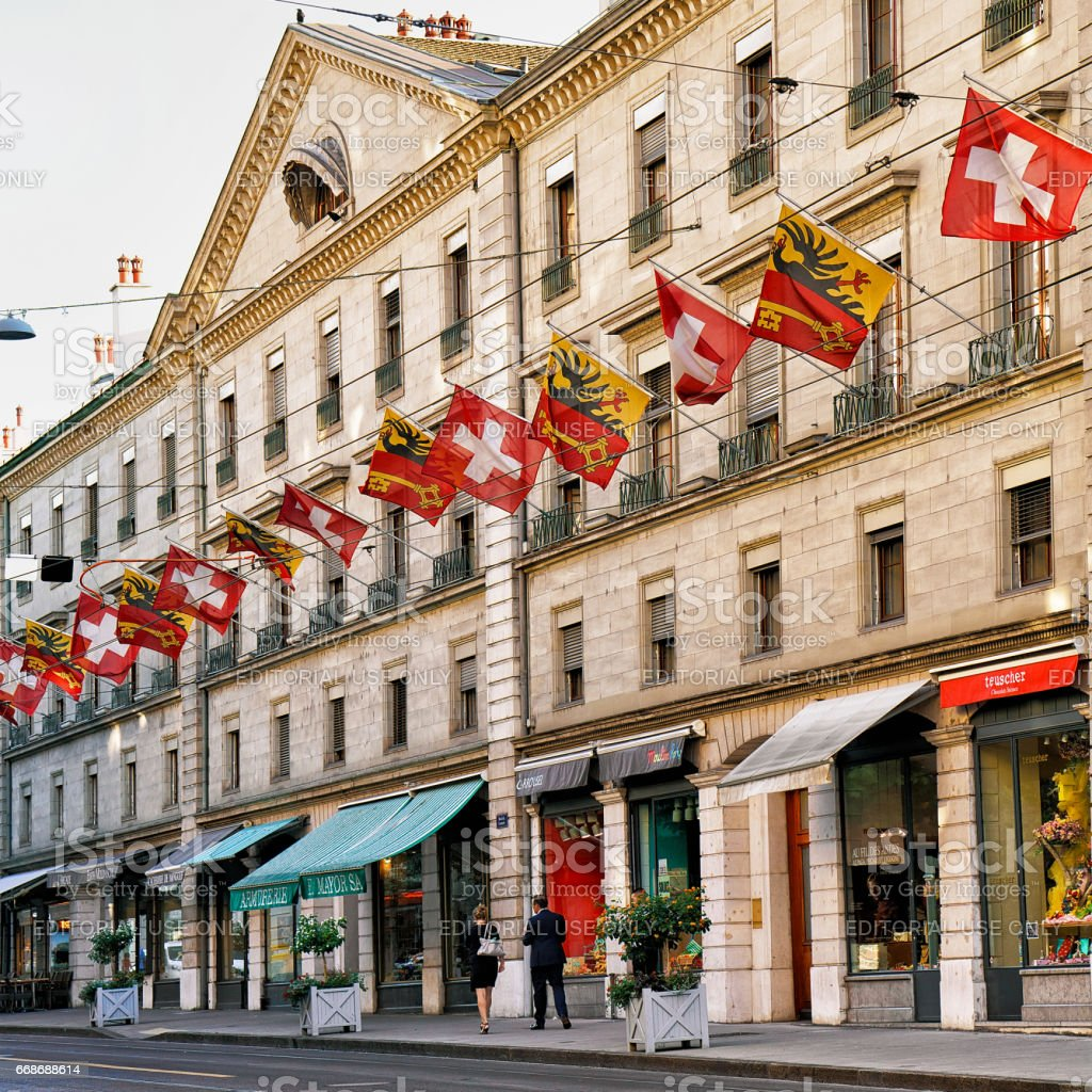 People in Rue Corraterie Street with flags in Geneva Switzerland stock photo
