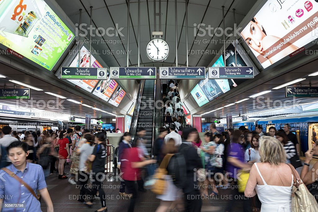 people in rush hour at BTS Siam public train station stock photo