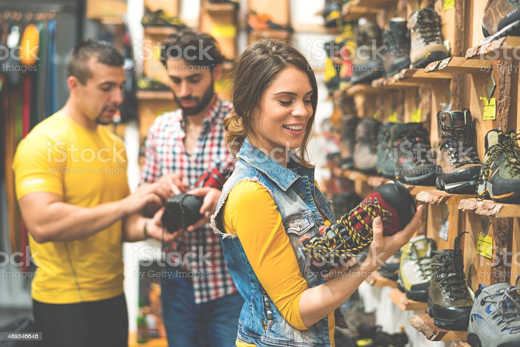 People in shoe store stock photo