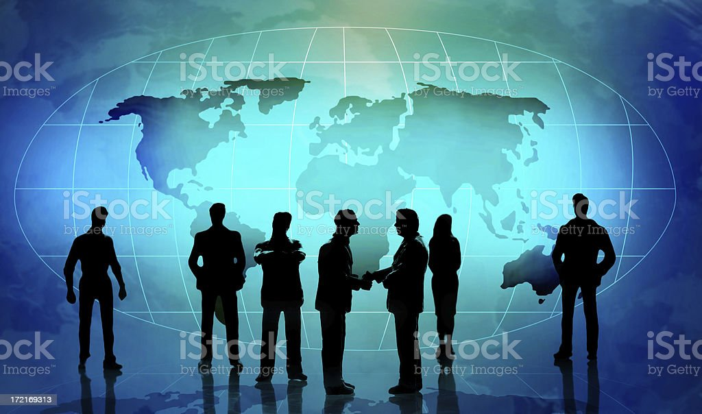 People in silhouette against blue global map royalty-free stock photo