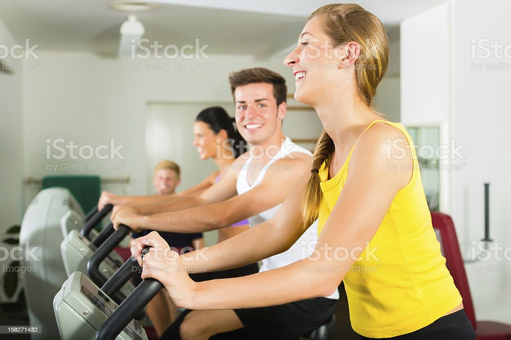 People in sport gym on the device royalty-free stock photo