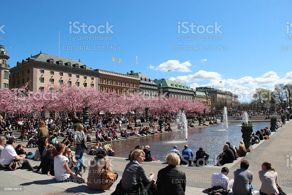 People in Stockholm enjoying the sun in the spring. stock photo