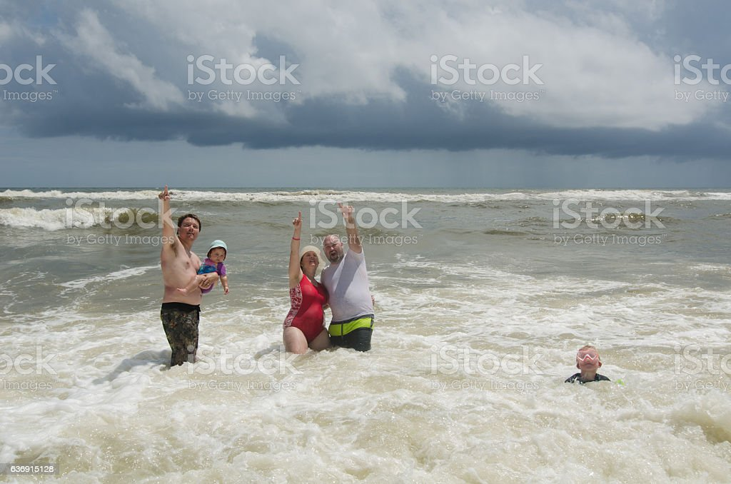 People in Surf Pointing Up stock photo