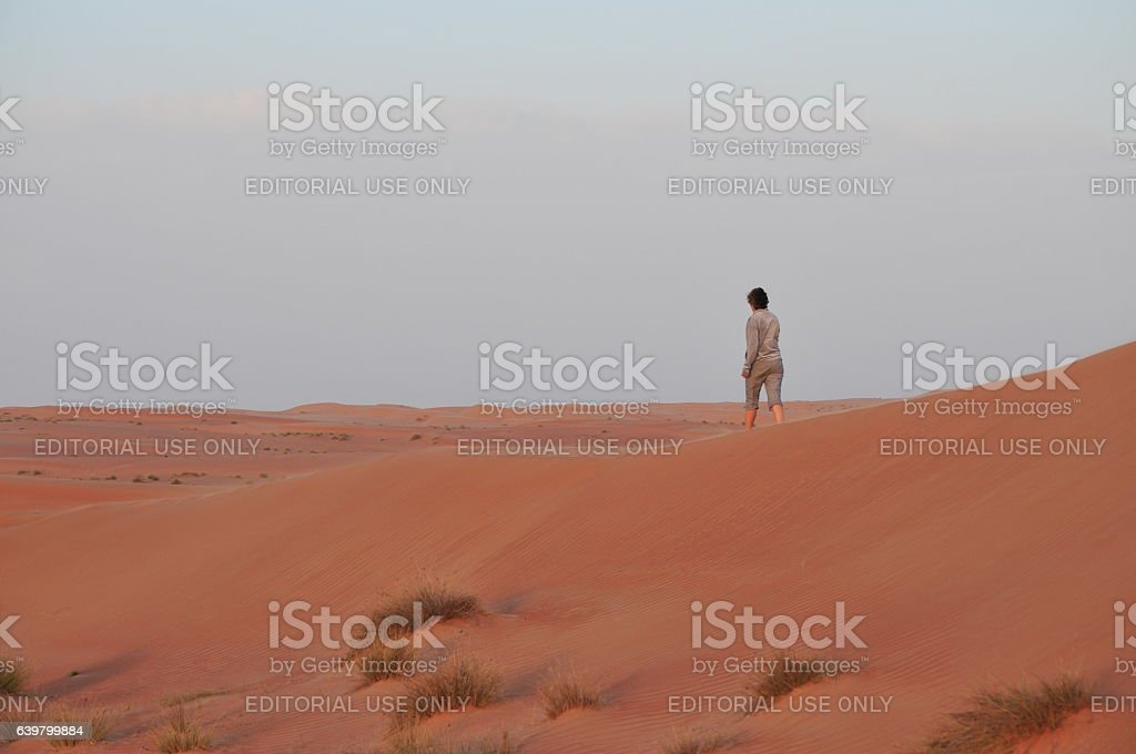 People in the desert stock photo