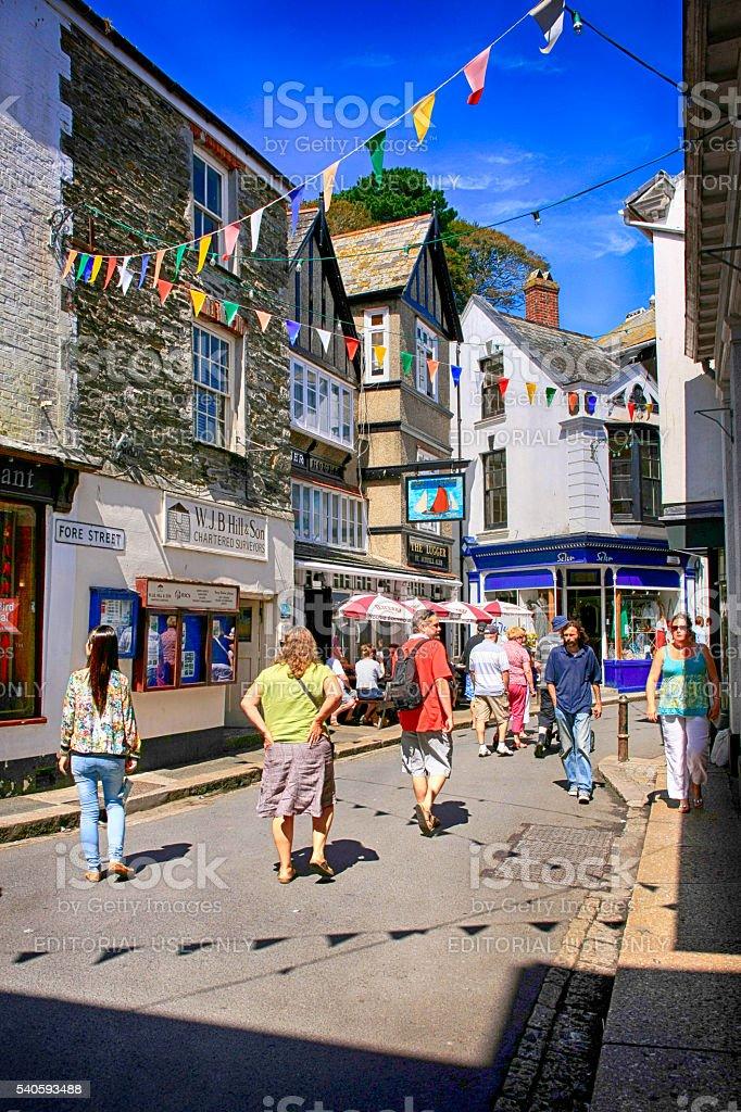People in the High Street in Fowey, UK stock photo