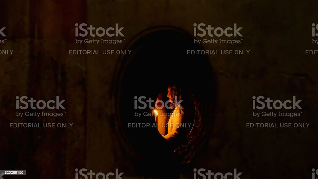 People in the Jesus Empty tomb in Jerusalem in the Holy Sepulcher...