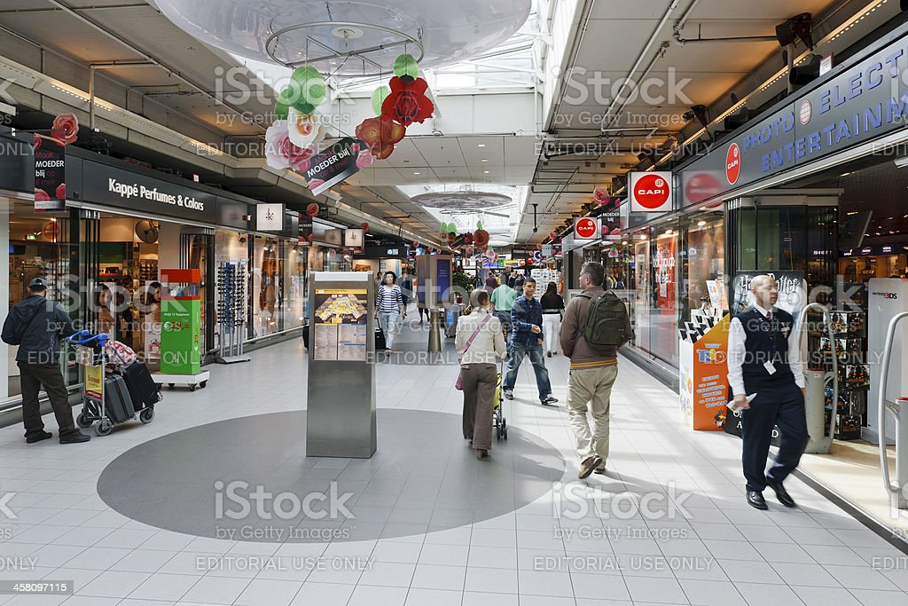 People in the Shopping mall at Schiphol Airport near Amsterdam royalty-free stock photo