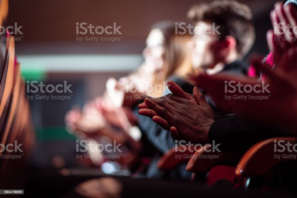 People in the theater, close up of clapping hands stock photo