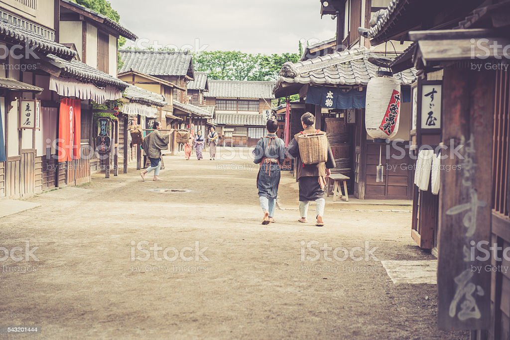 People in Traditional Costumes in Edo Town, Kyoto, Japan stock photo