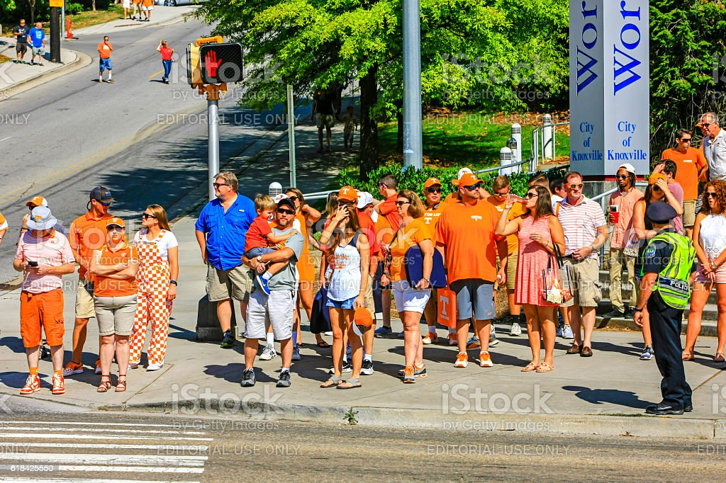 People in University of Tennessee team apparel in Knoxville, TN stock photo