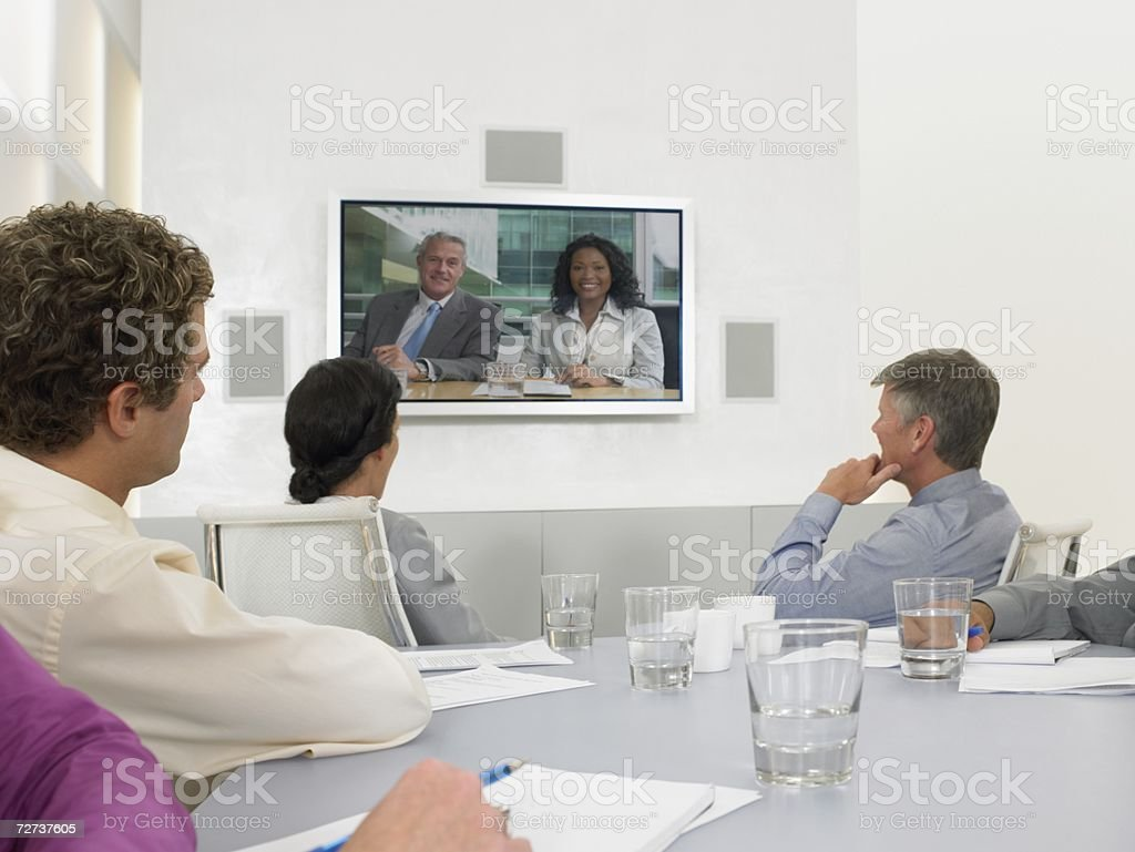 People in video conference meeting stock photo
