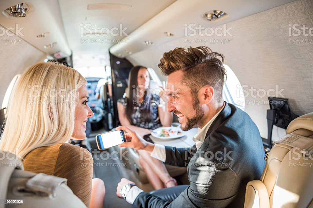 People inside jet airplane stock photo