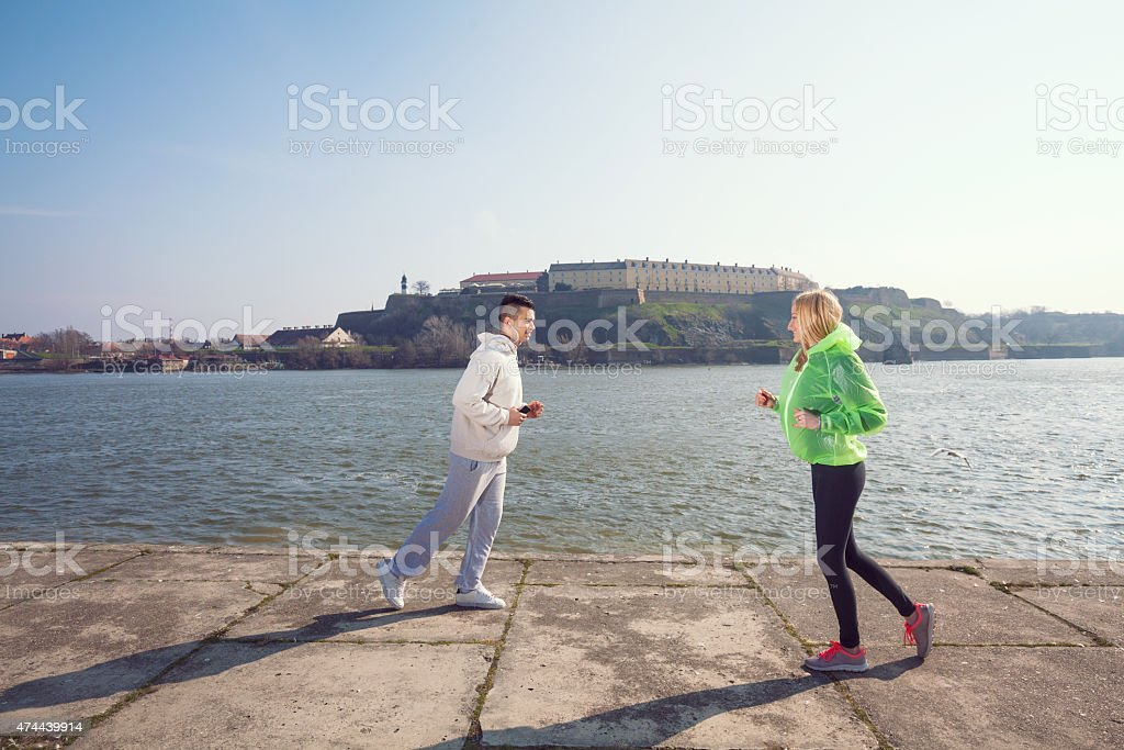 People Jogging by the River stock photo