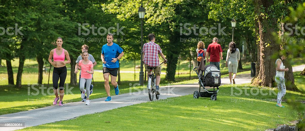 People jogging in park stock photo
