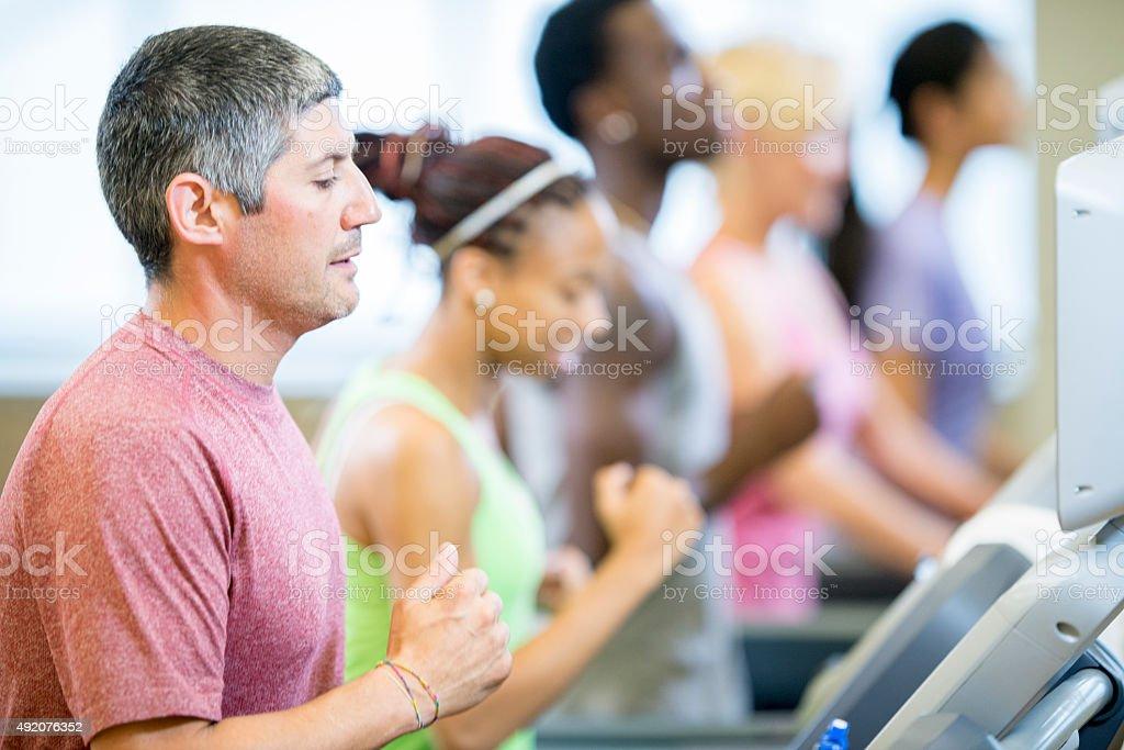 People Jogging on Treadmills stock photo