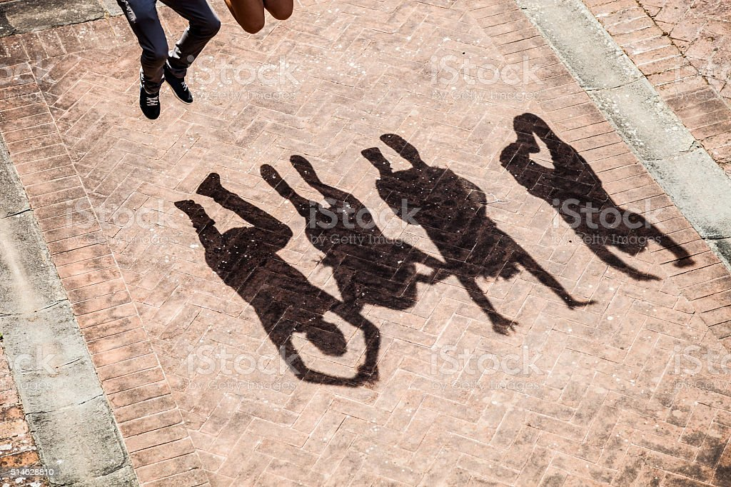 People jumping together stock photo