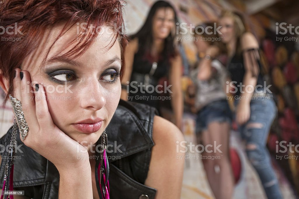 People Laughing at Young Woman stock photo