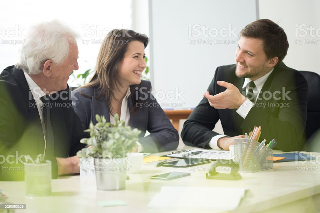 People laughing during business appointment stock photo