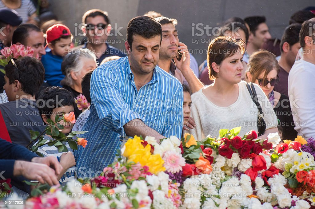 People laying down flowers on the genocide rembrance day stock photo