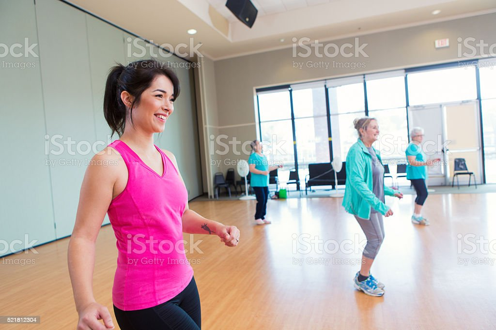 People learn line dancing at community center stock photo
