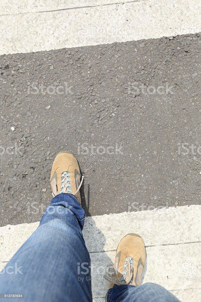 people legs walking on zebra crossing road stock photo