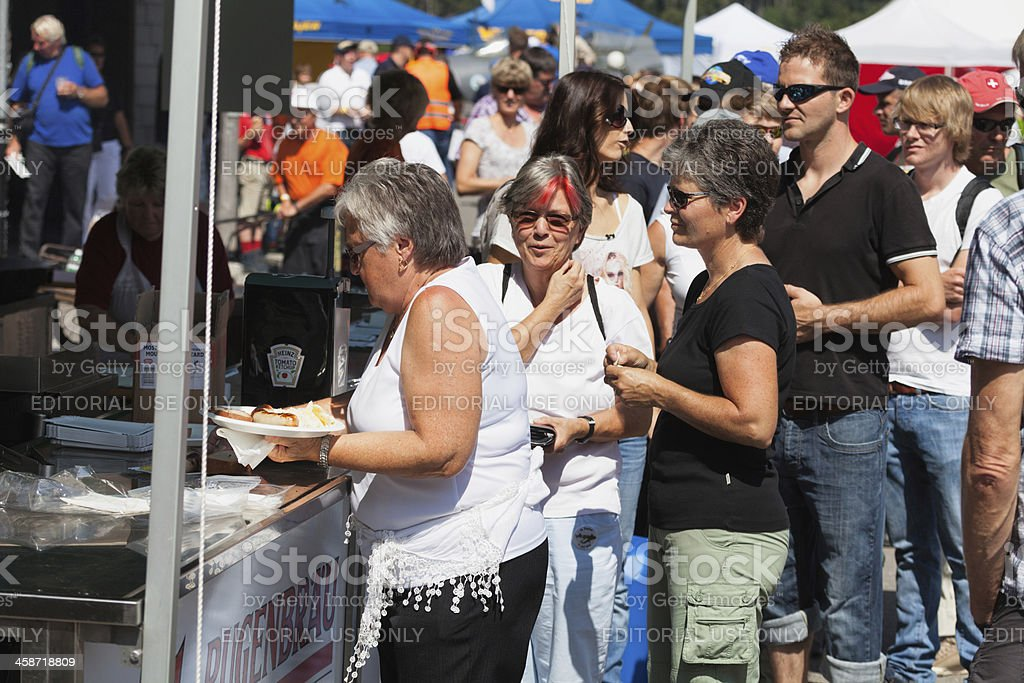People lined up for a bratwurst snack St. Stephan royalty-free stock photo