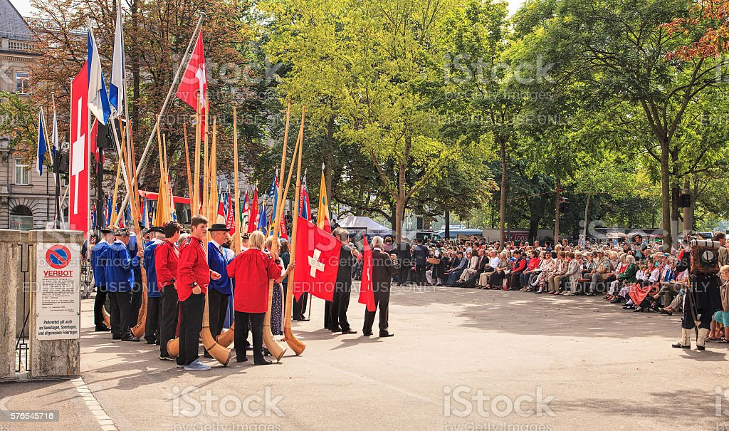 People listening to the speech devoted to the Swiss National Day stock photo
