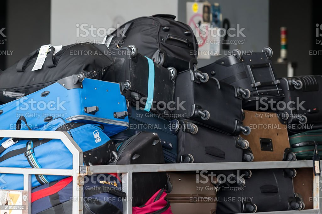 People loading luggage on the plane to the airport stock photo