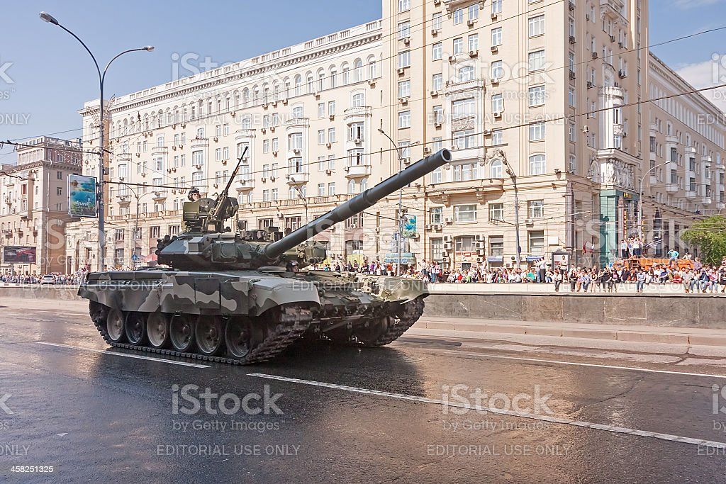 People look at T-90A tank on display during parade festivities royalty-free stock photo